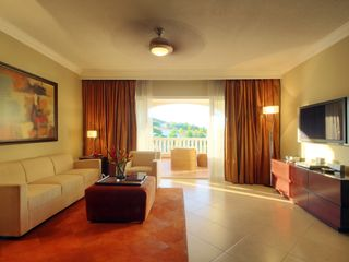 Playa Cofresi condo photo - Exit to Veranda from Main Living Area