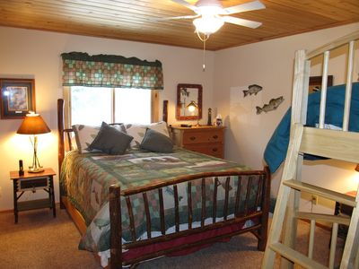Queen with bunk beds on main level with shared full bath in nearby hallway