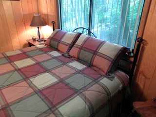 Dillard cabin photo - Master Bedroom With A King-Size Bed, Dresser, Closet, And Full Bathroom.