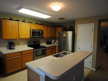 Kitchen with new stainless steel appliances. 3 door Fridge/freezr with ice maker