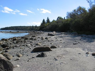Beach in front of the cottage at mid-tide, looking south