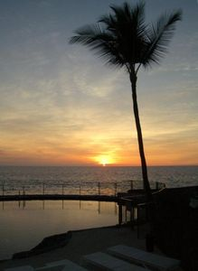 Sunset Over Oceanfront Pool