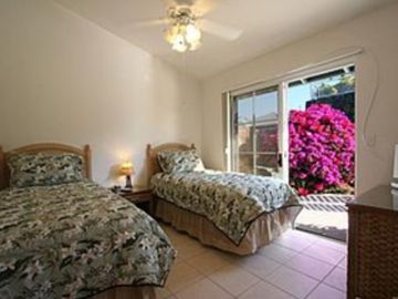 Third Bedroom with Twin Beds and Patio Doors Leading to Private Pool