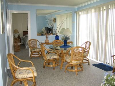 Dining area has sliding doors that open to balcony and ocean view!!