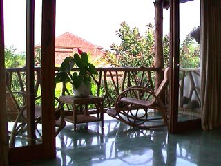 Sanur house photo - Upstairs french doors opening to balcony overlooking pool.