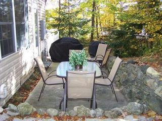 Petoskey condo photo - Our nature surrounded patio for relaxing or a cookout on the gas grill.