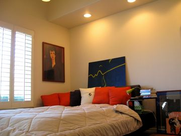Master bedroom with a sunrise and sunset view of the San Fernando Valley.