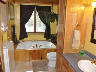 Colton house photo - Full Bath on 2nd Floor with Whirlpool Tub and Walk-in Shower + Washer and Dryer.