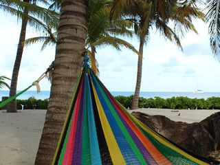 Ambergris Caye condo photo - Beautiful Caribbean Sea views from the hammocks..