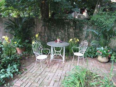 Brick garden patio where you can relax & even cook on the BBQ.