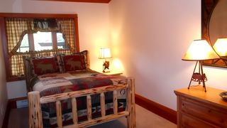 Lake Placid property rental photo - Bedroom with lake view, full bathroom across the hall