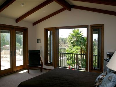 Two French Doors Leading to Deck & Balcony. Blinds are inside the window panes.