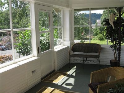 Enjoy the morning sun in the enclosed front porch.