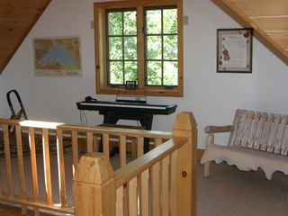 Lutsen house photo - loft with digital piano