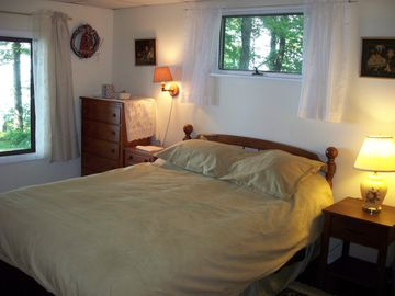Large bedroom has Queen bed and lake views.