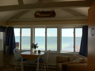 Yarmouth cottage photo - oceanview dining area, loveseat converts to twin bed for your child or guest