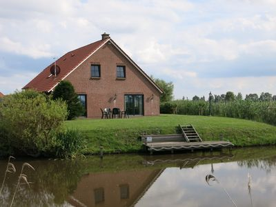 Exclusive apartment on the first floor. right on the canal with private dock