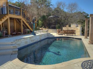 Austin estate photo - Villa featuring 3 deck areas, outdoor kitchen, fireplace & putting green