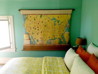 Rhinebeck house photo - A vintage literary map of the U.S. hangs above the queen bed in the blue bedroom