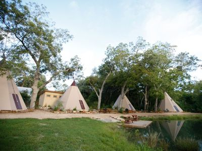 View of all 4 tipis at Geronimo Creek Retreat!
