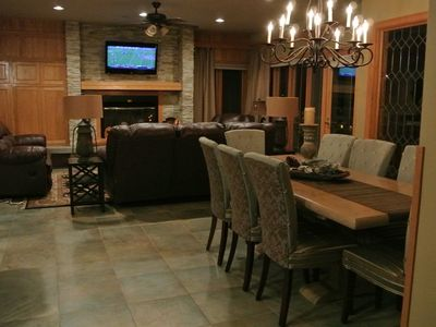 Den and dining area with remodeled fireplace and flat screen TV.