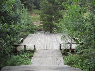 2600 Sq Feet of Deck Leading to the S Boulder Creek! - Nederland lodge vacation rental photo