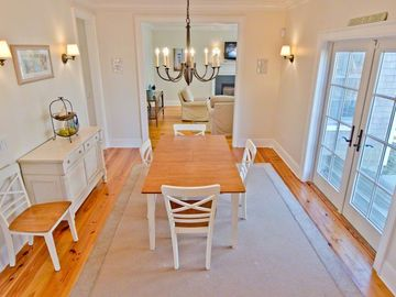 Sunny Dining Room Has French Doors That Lead To Bluestone Patio & Grilling Area