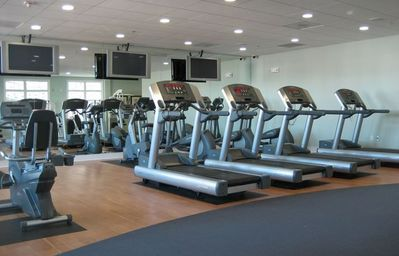 Fitness center with several flat screen TV's