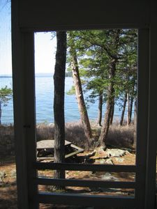 Alton cottage rental - Looking out the front porch screen door.
