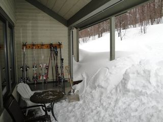 Bolton townhome photo - Back deck with ski racks-and lots of snow