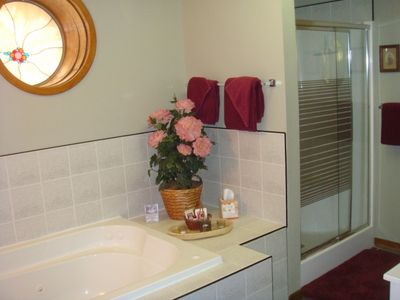 Butch Cassidy Suite bathroom with 2 person whirl pool tub and shower.