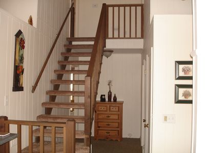 Staircase up to two bedrooms and two bathrooms