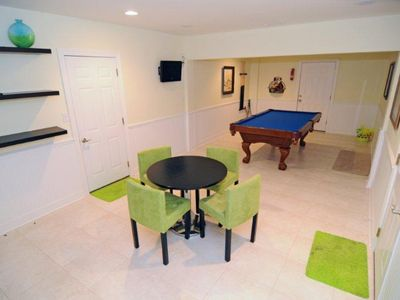 Game Room w LCD TV leads out to the pool level
