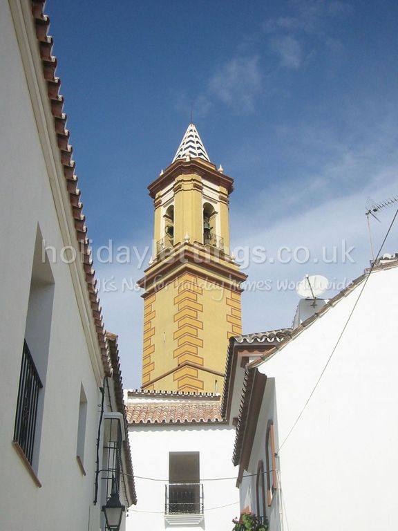 The beautiful church within the white walled town
