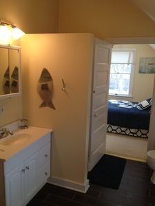 Upstairs bath with shower & door to bedroom w/ second door to hall.
