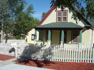 Colorado Springs house photo - Victorian home with large front porch.