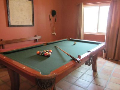 For your stay-at-vacation-home entertainment, a pool table is in-house.