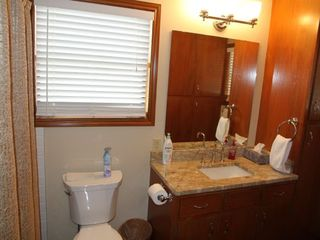 Master bathroom with granite counters and bath/shower. - Wimberley house vacation rental photo