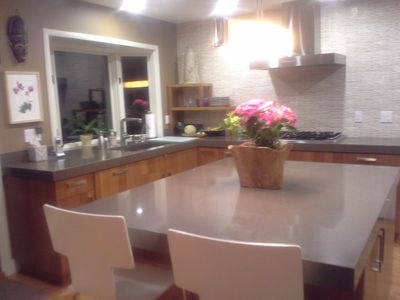 Kitchen with counter stools --- great for a quick bite or visiting the cook!