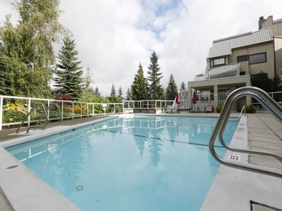 Heated seasonal outdoor pool surrounded by the forest is open mid-May to mid-Oct