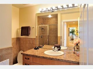 Key West condo photo - The Second Bathroom: Marble vanity, custom cabinets.