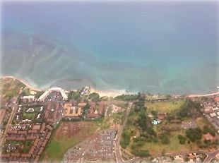 Menehune Shores from Airline Window, Horseshoe-shaped Building on Ocean