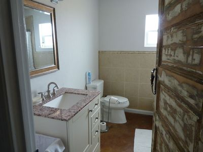 The bathroom. There is bath with shower behind that door. Towels provided
