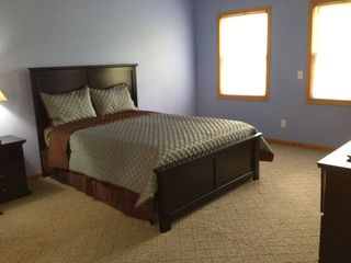 Utica house photo - Master suite features queen bed, ceiling fan and HDTV (w/ Dish and Blu Ray DVD)