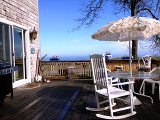 Rye condo photo - Large, Sunny deck. Rocking chairs, grille, TIKI bar, flower boxes and yard games