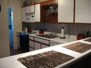 Fully furnished kitchen, large laundry room w/ washer & dryer.
