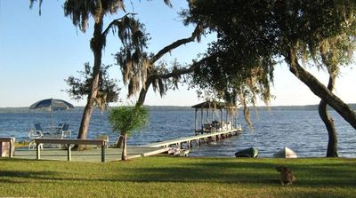 Lake front with dock, deck and beach area