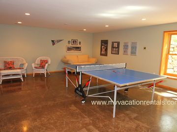 Lower Level Family Room with Ping Pong Table and Flat Screen TV