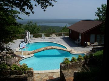 Greers Ferry Lake house rental - View of pool & poolhouse from top deck.