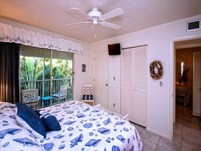 Master Bedroom with Balcony and King Bed and 32' flat screen with DVD player